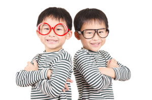 Two brother smiling on white background
